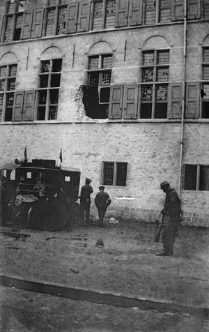 DAMAGE CAUSED BY THE FIRST SHELLS TO HIT YPRES