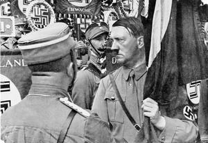 PHOTOGRAPHS OF ADOLF HITLER FROM THE GERMAN CIGARETTE CARD COLLECTORS' SERIES 'ADOLF HITLER' AND 'DEUTSCHLAND ERWACHT' 1934 - 1935