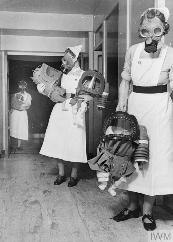 GAS DRILL AT A LONDON HOSPITAL: GAS MASKS FOR BABIES ARE TESTED, ENGLAND, 1940