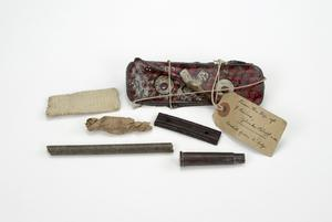 Oxo tin with shell, cordite and other relics
