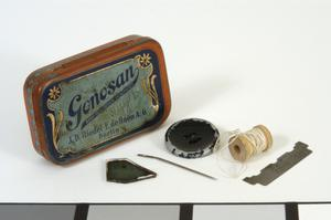 German lozenge tin with contents