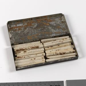 tin, containing cigarettes