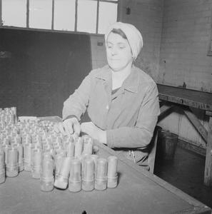 THE WOMEN BEHIND THE WOMEN: MUNITIONS WORK AT A ROYAL ORDNANCE FACTORY IN THE NORTH OF ENGLAND, c 1942