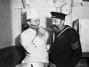 STIRRING THE CHRISTMAS PUDDING ON BOARD HMS COCHRANE, NOVEMBER 1940
