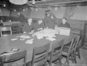 CHRISTMAS PREPARATIONS ON BOARD THE AIRCRAFT CARRIER HMS VICTORIOUS AT SCAPA FLOW, 17 DECEMBER 1941