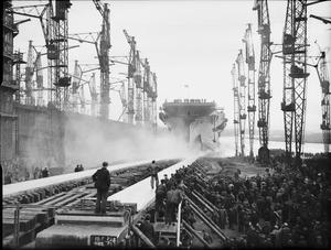 THE LAUNCHING OF THE AIRCRAFT CARRIER HMS INDEFATIGABLE AT GLASGOW, SCOTLAND, 8 DECEMBER 1942