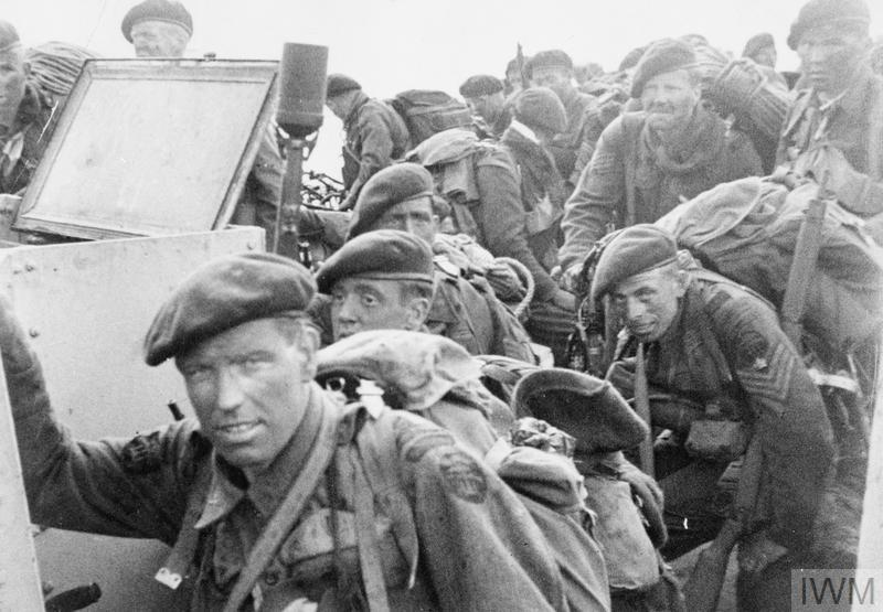 an account of events during the invasion of normandy in 1944 British troops come ashore at jig green sector, gold beach.