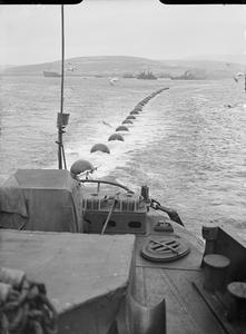 ROYAL NAVY VESSELS MAINTAIN THE BOOM DEFENCE AT SCAPA FLOW, SCOTLAND, MAY 1943