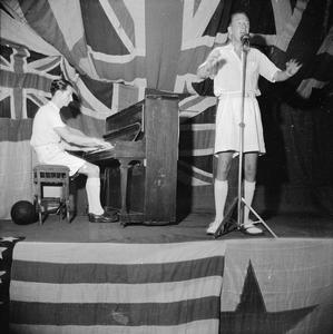 NOEL COWARD ENTERTAINS THE MEN OF THE EASTERN FLEET, HMS VICTORIOUS, TRINCOMALEE, CEYLON, 1 AUGUST 1944
