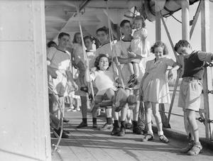 HMS BELFAST ENTERTAINS YOUNG BRITISH INTERNEES AT SHANGHAI, 1 OCTOBER 1945