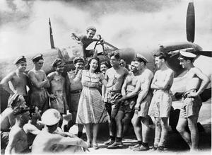 PAULA GREEN ENTERTAINING AT HMS RAJALIYA, IN THE FAR EAST, JUNE 1945.