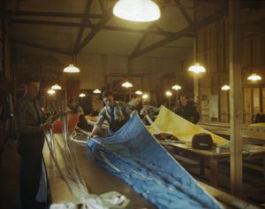 ROYAL AIR FORCE PARACHUTE PACKERS AT AN RAF GLIDER STATION IN BRITAIN, MAY 1944