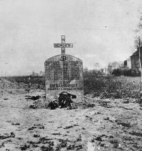 GRAVE OF THE 2ND EAST LANCASHIRE REGIMENT WHO WERE KILLED BY ONE SHELL ON 14TH MARCH 1915, DURING A RIFLE INSPECTION AT THE ROUGE CROIX CROSS ROADS ON THE LAS BASSEE ROAD