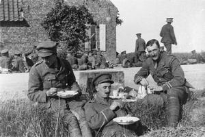 OFFICERS OF THE 2ND BATTALION ROYAL WARWICKSHIRE REGIMENT EATING LUNCH WHILE RESTING BY THE ROADSIDE, YPRES SALIENT