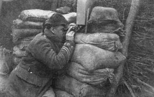 Image showing Captain J C Scott, 2nd A & SH. using box periscope with binoculars. Rue de Bois, February 1915