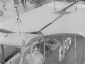 SEAPLANE FLYING OFF DECK OF HMS CAMPANIA [Main Title]