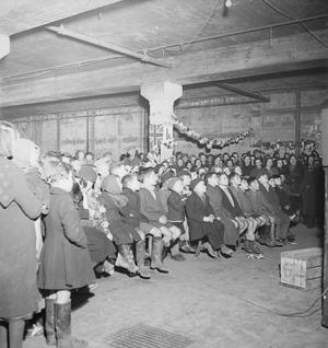 THE INAUGURAL FILM SHOW IN AN AIR RAID SHELTER CINEMA, BIRMINGHAM, ENGLAND, 1940