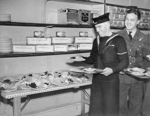 AMERICAN LEASE AND LEND FOOD BEING EATEN IN ENGLAND, UK, 1941