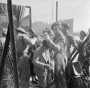 JEWISH IMMIGRANTS LEAVE HAIFA FOR INTERNMENT IN CYPRUS, AUGUST 1946
