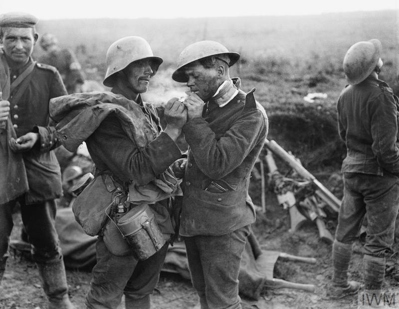 German Soldier lights a cigarette for a wounded English soldier after the Battle of Epehy, 18th September 1918, photo by Lt Thomas K. Aitken, Imperial War Museum (800 x 620)