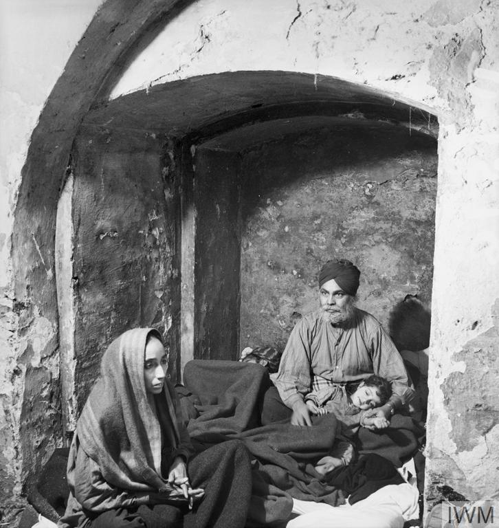 A Sikh family shelter in an alcove of the crypt during an air raid, Christ Church, Spitalfields, London – November 1940. [OS] [726×768]