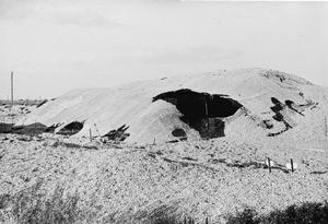 One of the centrifugal pump houses at Dungeness, camouflaged to resemble the surrounding gravel quarry in which it was sited.