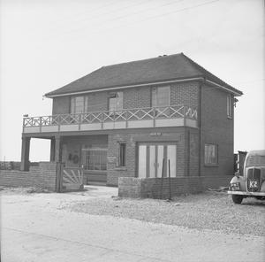 A house on the south coast of England, requisitioned by the British Army, and used to house pumping equipment.