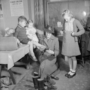 WOMEN'S VOLUNTARY SERVICE RUN CHILDREN'S CLOTHING EXCHANGE, NORWOOD, LONDON, 1943