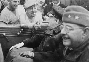 A FRENCH WORKER LIGHTS CHURCHILL'S CIGAR, CHERBOURG, FRANCE, 1944