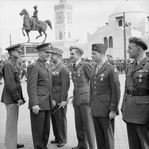 INVESTITURE CEREMONY FOR BRITISH, FRENCH, POLISH AND AMERICAN OFFICERS IN ALGIERS, 28 MARCH 1944