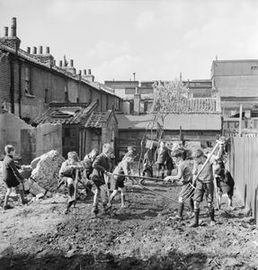 BRITAIN'S YOUTH PREPARES: BOYS CREATE ALLOTMENTS ON BOMB SITES, LONDON, ENGLAND, 1942