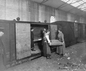 THE WOMEN'S WORK IN TRANSPORT SERVICES, 1914-1918