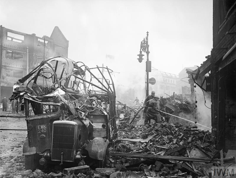 A wrecked bus stands among a scene of devastation in the centre of Coventry