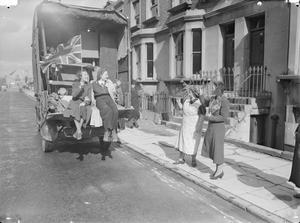 LONDON SHOWS THE FLAG: LIFE GOES ON IN WARTIME LONDON, ENGLAND, 1940