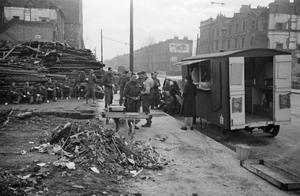 BLITZ CANTEEN: WOMEN OF THE WOMEN'S VOLUNTARY SERVICE RUN A MOBILE CANTEEN IN LONDON, ENGLAND, 1941