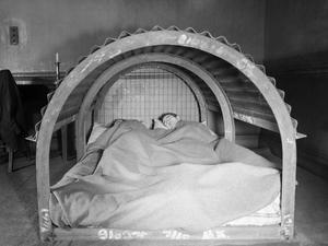 CIVIL DEFENCE IN BRITAIN: INDOOR AIR RAID SHELTER, 1941