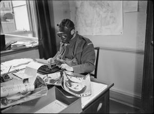 AIR RAID PRECAUTIONS IN BRITAIN: STAFF OF THE MINISTRY OF INFORMATION WEAR GAS MASKS TO WORK, LONDON, ENGLAND, 1941