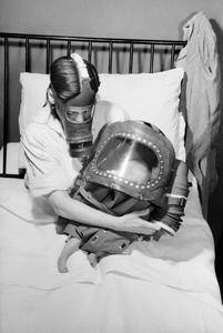 AIR RAID PRECAUTIONS ON THE BRITISH HOME FRONT: MOTHER AND BABY IN GAS MASKS, C 1941