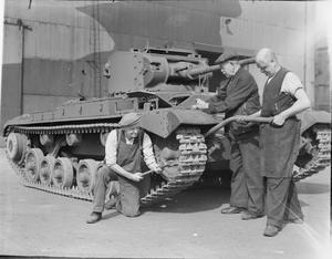 VETERAN WAR WORKERS GO TO IT!: PENSIONERS BUILD A TANK, ENGLAND, 1941