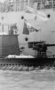 HMS MOONSTONE CAPTURES ITALIAN SUBMARINE. 1940, THE ITALIAN SUBMARINE GALILEO GALILEI WHICH WAS CAPTURED BY HM TRAWLER MOONSTONE IN THE GULF OF ADEN. THE SUBMARINE SURRENDERED AFTER MOONSTONE DROPPED DEPTH CHARGES.