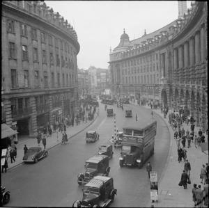 ON THE MOVE IN WARTIME LONDON, 1942