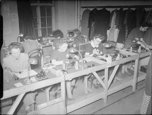 THEY ALSO FIGHT WHO ONLY STAND AND WAIT: FEMALE REFUGEES ASSEMBLE ELECTRICAL EQUIPMENT, 1942