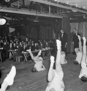 PTs FOR LUNCH: PHYSICAL TRAINING IN THE CANTEEN OF A SOUTHERN SMALL ARMS FACTORY, ENGLAND, 1943
