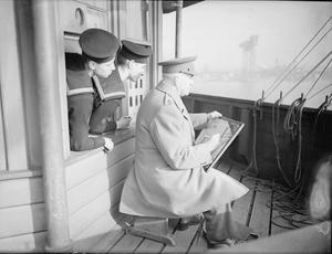 SIR MUIRHEAD BONE AT WORK. 1940, ON BOARD ONE OF HM SHIPS IN HARBOUR.
