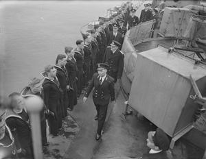 COMMANDER IN CHIEF, PLYMOUTH, ADMIRAL SIR MARTIN DUNBAR-NASMITH, VC, KCB, INSPECTS THE DESTROYER HMS KELVIN. 1941, DURING HIS INSPECTION THE C IN C MET HIS SON, SUB LIEUTENANT D A DUNBAR-NASMITH, SERVING IN THE DESTROYER.