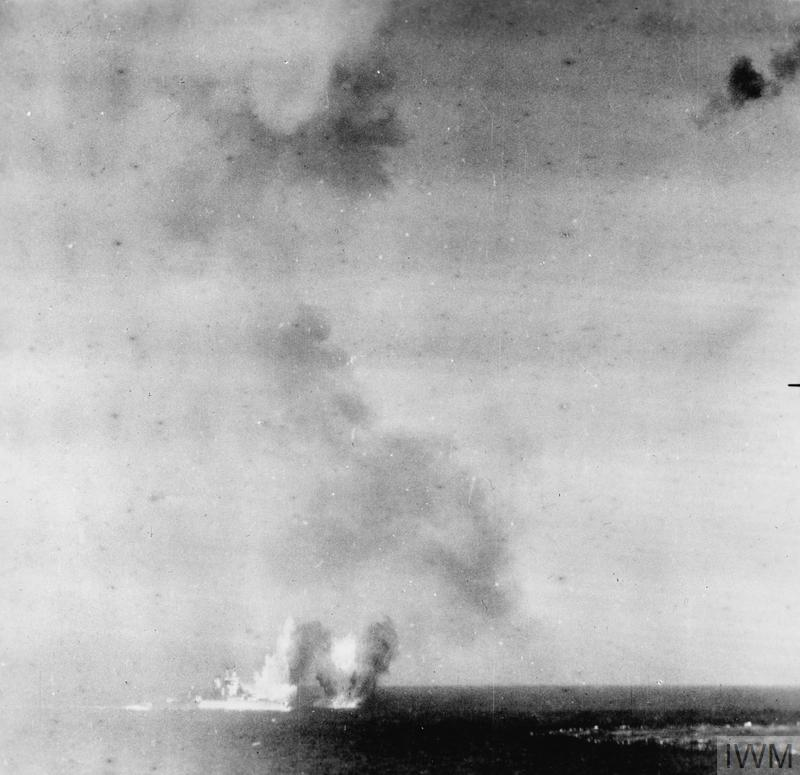 HMS ILLUSTRIOUS ATTACKED BY DIVE BOMBERS. 10 JANUARY 1941, IN THE MEDITERRANEAN OFF THE ITALIAN ISLAND OF PANTELLERIA. IN THE FIRST ACTION BY GERMAN BOMBERS IN THE MEDITERRANEAN, HMS ILLUSTRIOUS SURVIVED A FEROCIOUS ATTACK INCLUDING THAT OF OVER 40 JU-87'S AND JU-88'S, TO MAKE IT MALTA.