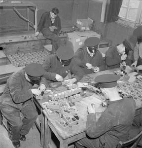 NATIONAL FIRE SERVICE ON WAR PRODUCTION: WAR WORK IN A FIRE STATION, LONDON, ENGLAND, UK, 1943
