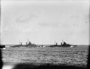 BRITISH NAVAL ESCORT AND CONVOY IN MEDITERRANEAN, SEPTEMBER 1941, ON BOARD HMS SHEFFIELD, ESCORTING A MALTA CONVOY IN THE MEDITERRANEAN (OPERATION HALBERD). THE CONVOY GOT THROUGH TO MALTA AFTER BEING ATTACKED BY THREE GROUPS OF ENEMY TORPEDO CARRYING AIRCRAFT HEAVILY ESCORTED BY FIGHTERS IN THE CENTRAL MEDITERRANEAN. 14 ENEMY AIRCRAFT WERE DESTROYED AND HMS NELSON WAS DAMAGED BY AN AERIAL TORPEDO.