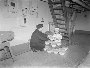 CHRISTMAS PREPARATIONS ON BOARD HMS VICTORIOUS. 17 DECEMBER 1941, ON BOARD THE AIRCRAFT CARRIER AT SCAPA FLOW.