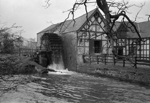 WATER MILL AT WAR: EVERYDAY LIFE AT ERBISTOCK MILL, NEAR RUABON, DENBIGHSHIRE, WALES, UK, 1944